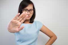 NO on her hand. Young woman showing her denial with NO on her hand Royalty Free Stock Images