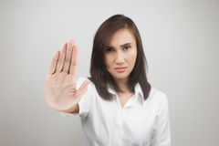 NO on her hand. Young woman showing her denial with NO on her hand royalty free stock photography