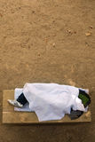 Homeless. A man sleeping on a stone bench seen from above. His is covered with a sheet. Riverbank of the Seine, Paris, France Stock Photos