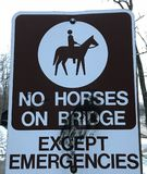 NO HORSES ON BRIDGE EXCEPT EMERGENCIES. The Cleveland Metroparks has a fine set of paths and parks. Cleveland Metroparks is an extensive system of nature Royalty Free Stock Image