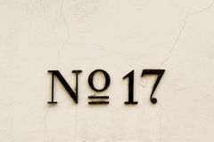No. 17. House number 17 on a beige facade Royalty Free Stock Photography