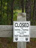 No Hunting Sign. A no hunting or trapping sign on a fence in a state forest. Posted by the Florida Department of Agriculture and Consumer Services, a Division of Stock Photos