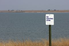 No Hunting Sign Near Lake Royalty Free Stock Photo