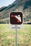 No Hunting Sign on Public Land. No Hunting Sign with graphic on Public Land in the Painted Hills. The Painted Hills Unit is located in John Day Fossil Beds royalty free stock photography