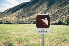 No Hunting Sign on Public Land. No Hunting Sign with graphic on Public Land in the Painted Hills. The Painted Hills Unit is located in John Day Fossil Beds royalty free stock images