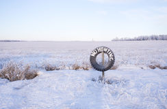 No hunting tire hanging on post Royalty Free Stock Image