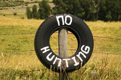 No Hunting on a Tire outside of Medicine Bow National Forest, Wy royalty free stock image