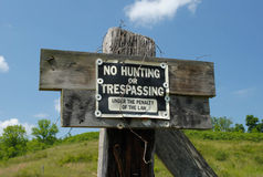 No Hunting or Trespassing. Homemade wooden No Hunting or Trespassing sign Royalty Free Stock Images