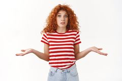 No idea. Confused doubtful attractive redhead curly woman looking perplexed shrugging uncertain raise eyebrows clueless. Standing questioned troubled answer royalty free stock photos