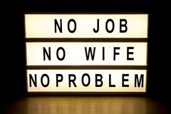 No job, no wife, no problem light box sign board. On wooden table Royalty Free Stock Photos