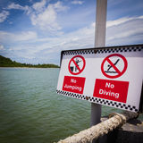 No jumping and no diving plate. For tourist Stock Photos