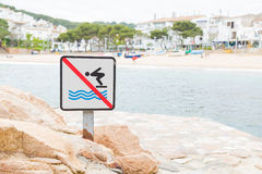 No jumping into the water allowed sign in Tamariu, Spain Royalty Free Stock Image