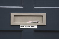 No junk mail. House letterbox with 'No junk mail' sign and junk mail Royalty Free Stock Photos