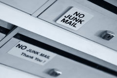 No Junk Mail. Door with a name plaque, a post slot and a no junk mail sign royalty free stock photo