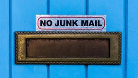 No Junk Mail. A brass letter box with a sign above indicating new junk mail wanted stock image
