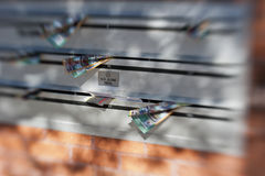 No Junk Mail through a Lensbaby. Mail boxes with junk mail in the slots including the one with a sign on it shot using a Lensbaby lens. Copyspace royalty free stock image