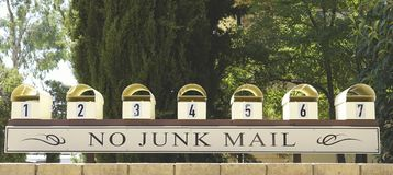 No Junk Mail Please. No Junk Mail Sign on Mail box of an apartment Stock Photo
