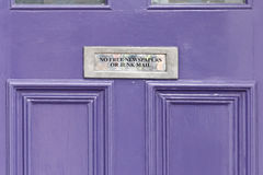 No junk mail precaution on door, London. England Royalty Free Stock Photos
