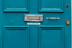 No junk mail precaution on door, London. England Royalty Free Stock Images