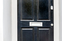 No junk mail precaution on door, London. England Royalty Free Stock Image