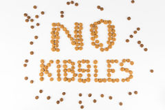 NO KIBBLES words, formed using actual dog food kibbles Royalty Free Stock Photography