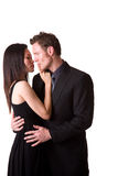 No kissing. Young Asian woman stopping a Caucasian hunk from kissing her Stock Image