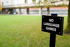 Egidija Čiricaite's sign saying 'no language games'. Artist Egidija Čiricaite's sign saying 'no language games' on a lawn ouside the philosophy faculty Royalty Free Stock Image