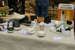 No leather sneakers in vegan and animal activists products fair where farmers and companies show their products to consumers. Turin Italy March 30 2019 royalty free stock photo