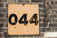 No: 44 on brick wall Royalty Free Stock Photos