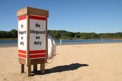 No Life Gaurd on Duty. No Life Guard On Duty post on a small inland lake beach Stock Images