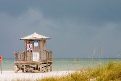No lifeguard on duty. Old lifeguard station on Stormy Gulf Coast Beach Royalty Free Stock Image