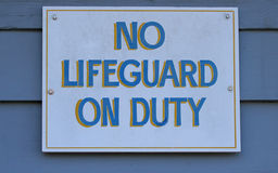 No Lifeguard on Duty. Sign at local swimming hole Stock Photos