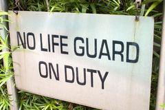 No lifeguard on duty sign stock images