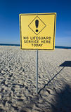 No lifeguard sign. A signboard stating the absence of a lifeguard Royalty Free Stock Photography