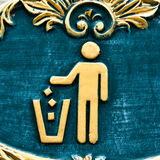 No littering. Figure of person throwing garbage into a trash can Stock Images