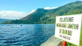 No littering. Dilarang membuang sampah means no littering - a signage in lake toba area north sumatra indonesia Stock Photography