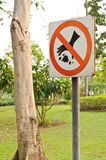 No littering sign. In a garden Royalty Free Stock Photo
