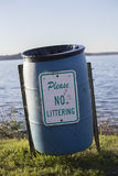 No Littering Sign. On an empty garbage can on a lakeshore Royalty Free Stock Photo