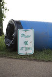 No Littering. Sign on an overturned garbage can Royalty Free Stock Images