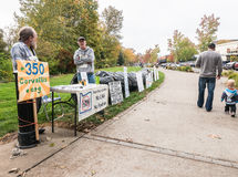 No LNG volunteers stand by plastic bag pipeline with signs at Co. Corvallis, Oregon, October 24, 2015: No LNG pipeline volunteers from 350.org stand by pipeline Stock Photography