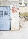 No Loafing warning sign on a building Royalty Free Stock Images