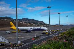 Funchal Airport Madeira. The no longer airline Monarch aircraft on the tarmac at Funchal airport on the Portuguese Island of Madeira royalty free stock images