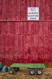 No Manure. White sign No Manure Dumping Here on red barn wall Stock Image