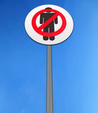 No men isolated against a bright blue sky. Road sign, depicting no men isolated against a bright blue sky Royalty Free Stock Photo