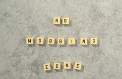 No Mobbing Zone game tiles on grey dabbled stone background Royalty Free Stock Photos