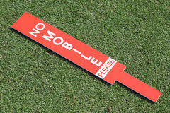 The no mobile sign place on green in golf tournament. Royalty Free Stock Images