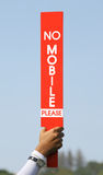 The no mobile sign was held up by volunteer in golf tournament. Royalty Free Stock Photos