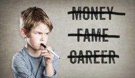 No money, fame, career, Boy on grunge background Stock Photos