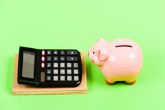 No money. planning counting budget. Commerece business. bookkeeping. financial report. moneybox with calculator. Piggy stock image