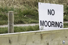 No Mooring sign. By a mooring point at the side of a river Stock Photo
